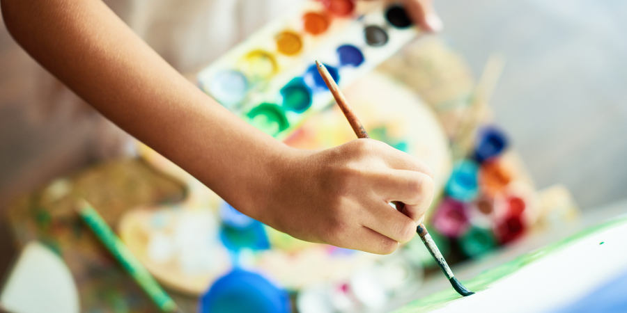 photo of hand painting with water colour